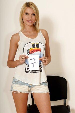 Slender blonde model Karina Grand showcases her pussy after standing bare