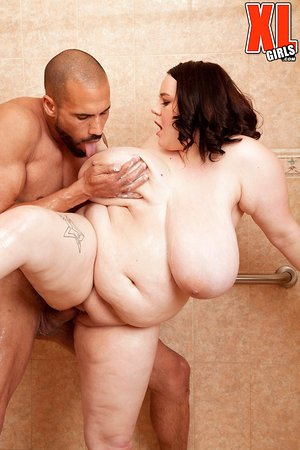 Obese brunette Peyton Thomas catches a load of cum on her mega boobs in shower
