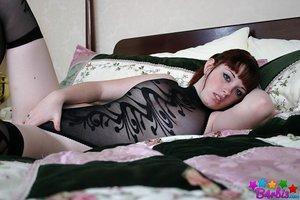 Cute amateur B4rbi3 in black sheer lingerie and pantyhose posing on the bed