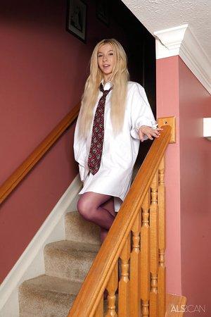 Skinny blonde Kenzie Reeves makes nude posing debut in purple tights