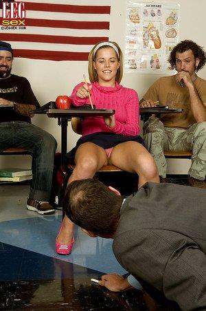 Teen student Charlie Lynn gives teacher a sexy footjob in the classroom