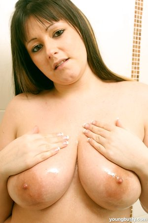 Teenage slut Abi B strips down nude and washes her big natural breasts