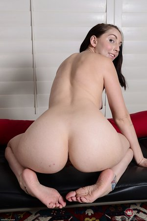 Hairy pubis and crotch of naughty Nickey Huntsman presented on the couch