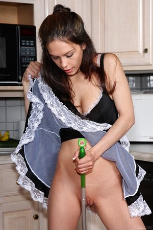 Charming maid Austin Reines finds exotic ways to please herself in the kitchen
