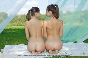 Hot lesbian girls Susana C & Nastya K tribbing & posing naked to show sexy ass
