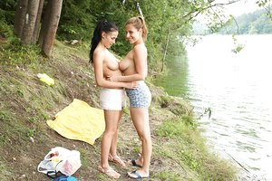 Nicole Love and her barely legal girlfriend have sapphic sex in the forest