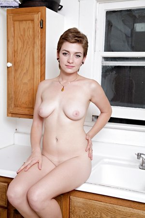 Cute petite amateur Lila Lavay sheds her sun dress in the kitchen to spread