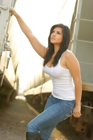 Black-haired hotty Sunny Leone in white shirts